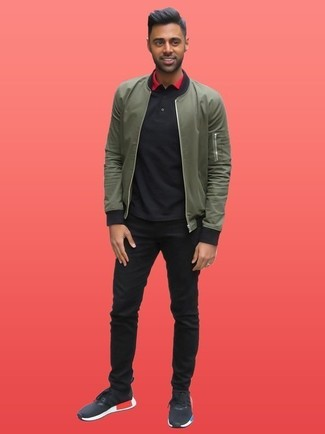 How to wear: olive bomber jacket, black polo, black jeans, black athletic shoes