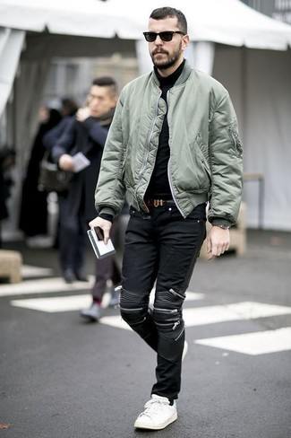 How To Wear an Olive Bomber Jacket With Black Jeans For Men: This pairing of an olive bomber jacket and black jeans makes for the perfect foundation for a casually dapper ensemble. When not sure about what to wear on the footwear front, complete your ensemble with a pair of white leather low top sneakers.