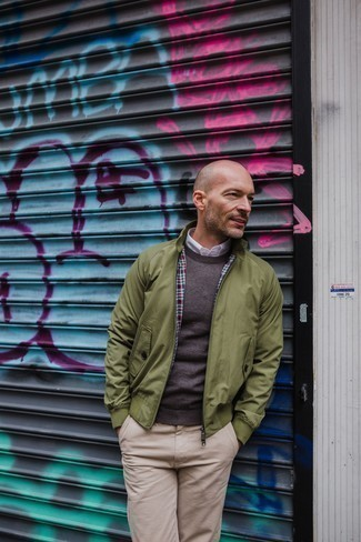 Men's Looks & Outfits: What To Wear In 2020: An olive bomber jacket and beige chinos are essential in any modern man's great off-duty collection.