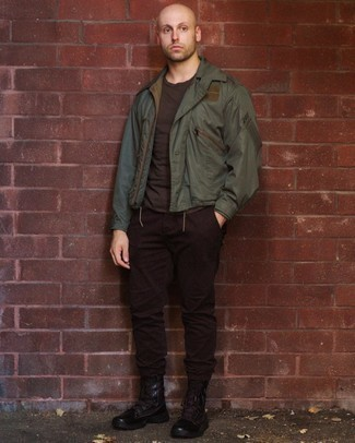 Olive Bomber Jacket Outfits For Men: An olive bomber jacket and dark brown chinos are a combo that every style-conscious guy should have in his casual styling collection. A trendy pair of dark brown leather work boots is an easy way to transform this outfit.