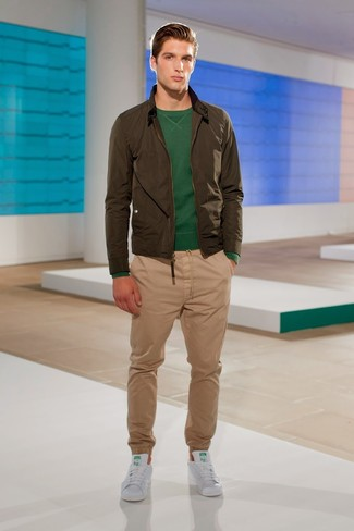 How to wear: olive bomber jacket, dark green crew-neck sweater, khaki chinos, white leather low top sneakers