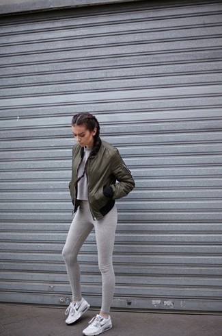 How to wear: olive bomber jacket, grey cropped sweater, grey leggings, white athletic shoes