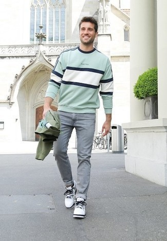 Olive Bomber Jacket Outfits For Men: An olive bomber jacket and grey jeans are the kind of a winning off-duty getup that you need when you have no time to spare. Want to tone it down when it comes to shoes? Add white and black canvas high top sneakers for the day.