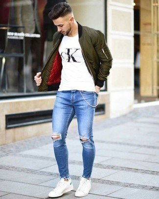 How to Wear White Leather Low Top Sneakers In a Relaxed Way For Men: An olive bomber jacket and blue ripped jeans are a cool getup to carry you throughout the day and into the night. Go down a classier route in the footwear department by rounding off with a pair of white leather low top sneakers.
