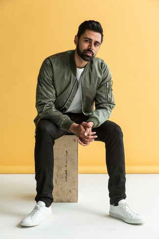 How To Wear an Olive Bomber Jacket With Black Jeans For Men: Try teaming an olive bomber jacket with black jeans for both dapper and easy-to-style ensemble. Complete this look with white leather low top sneakers and ta-da: the getup is complete.