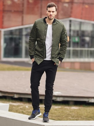 How To Wear an Olive Bomber Jacket With Black Jeans For Men: Such items as an olive bomber jacket and black jeans are the perfect way to introduce effortless cool into your daily casual wardrobe. If you need to effortlesslly dial down this outfit with a pair of shoes, why not introduce a pair of black athletic shoes to this look?