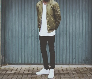 How to Wear White Leather High Top Sneakers For Men: For a casual ensemble with a clear fashion twist, opt for an olive nylon bomber jacket and black jeans. Take a more laid-back approach with footwear and complete this ensemble with a pair of white leather high top sneakers.