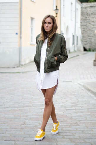 Olive Bomber Jacket Casual Outfits For Women: Why not try teaming an olive bomber jacket with a white shirtdress? As well as totally functional, these pieces look nice when worn together. Introduce a pair of yellow low top sneakers to this look and the whole ensemble will come together.