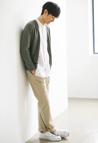 Olive Cardigan Outfits For Men: If you would like take your off-duty game up a notch, consider pairing an olive cardigan with khaki chinos. Not sure how to round off? Complement your outfit with a pair of white canvas low top sneakers for a more laid-back spin.