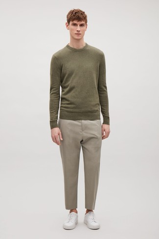 How to wear: olive crew-neck sweater, beige dress pants, white leather low top sneakers