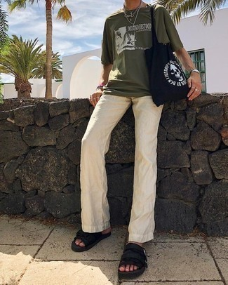 How to Wear Beige Linen Chinos: Why not wear an olive print crew-neck t-shirt with beige linen chinos? As well as very comfortable, both of these items look nice paired together. Bring a carefree feel to your ensemble by rocking a pair of black canvas sandals.