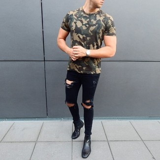 How to wear: olive camouflage crew-neck t-shirt, black ripped skinny jeans, black leather chelsea boots, silver watch