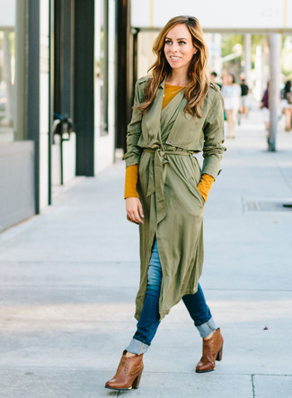 How to wear: olive duster coat, mustard long sleeve t-shirt, navy skinny jeans, brown leather ankle boots