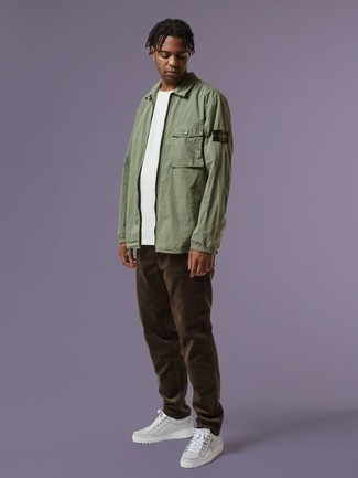 Olive Harrington Jacket Outfits: Wear an olive harrington jacket and dark brown corduroy chinos for a laid-back kind of class. Why not rock a pair of white canvas low top sneakers for a more casual vibe?