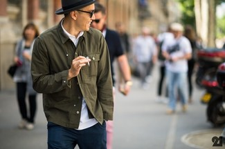 An olive green button-down shirt with navy casual trousers has become an essential combination for many style-conscious men.
