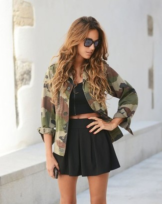 How to wear: olive camouflage military jacket, black cropped top, black skater skirt, dark brown leopard sunglasses