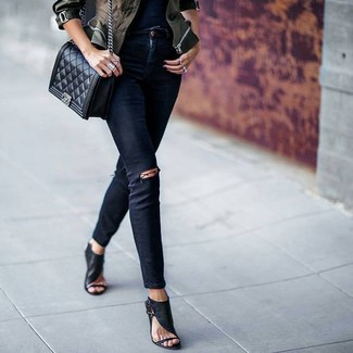 How to wear: olive camouflage military jacket, black ripped skinny jeans, black leather heeled sandals, black quilted leather crossbody bag