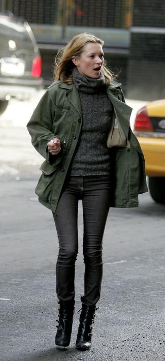 An olive green military jacket and charcoal skinny jeans are a great outfit formula to have in your arsenal. Elevate your getup with black leather ankle boots.