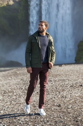 How to wear: olive military jacket, navy crew-neck sweater, burgundy chinos, white leather low top sneakers