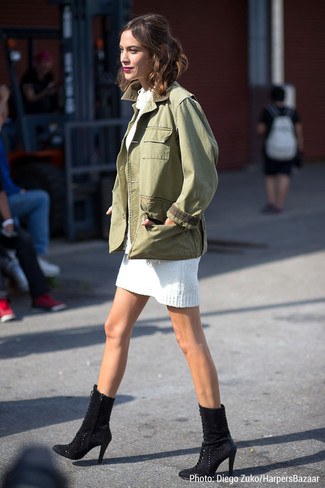 Alexa Chung wearing Olive Military Jacket, White Sweater Dress, Black Suede Ankle Boots
