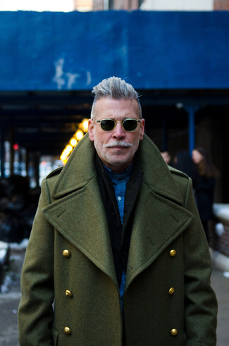 Nick Wooster wearing Olive Overcoat, Black Blazer, Navy Long Sleeve Shirt