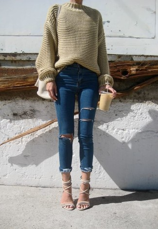 How to wear: olive oversized sweater, blue ripped skinny jeans, beige leather heeled sandals, white leather crossbody bag