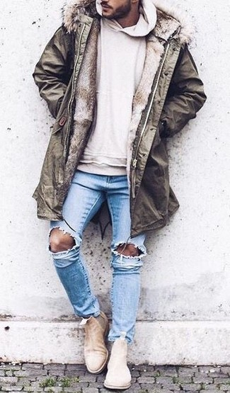 An olive parka and light blue ripped skinny jeans are your go-to outfit for lazy days. Lift up this getup with beige suede chelsea boots. The much awaited spring calls for sharp looks just like this one.