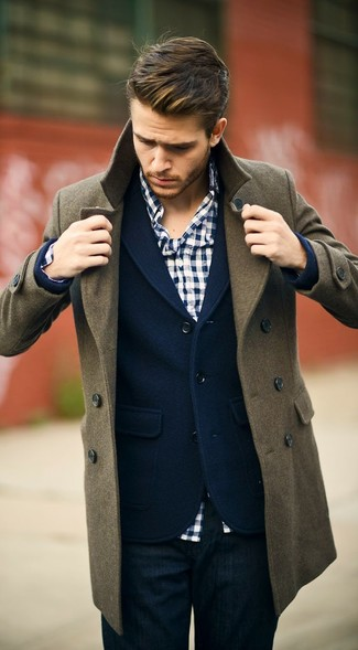 An olive green pea coat and navy blue jeans are a great outfit formula to have in your arsenal.