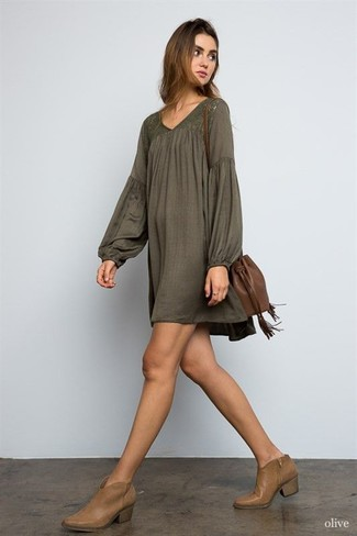 How to wear: olive peasant dress, brown leather ankle boots, brown leather bucket bag