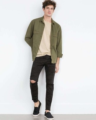 How to wear: olive shirt jacket, beige crew-neck t-shirt, black ripped jeans, black slip-on sneakers