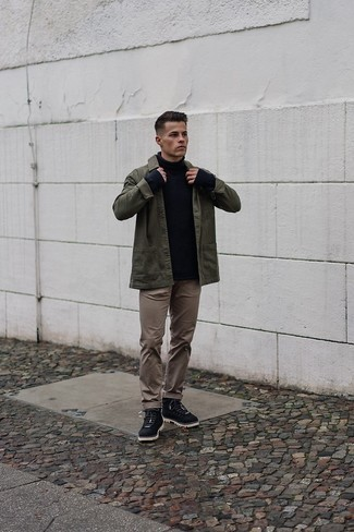 Black Leather Work Boots Outfits For Men: For an effortlessly classic menswear style, marry an olive shirt jacket with brown chinos — these two pieces work really great together. Introduce a pair of black leather work boots to the equation to loosen things up.