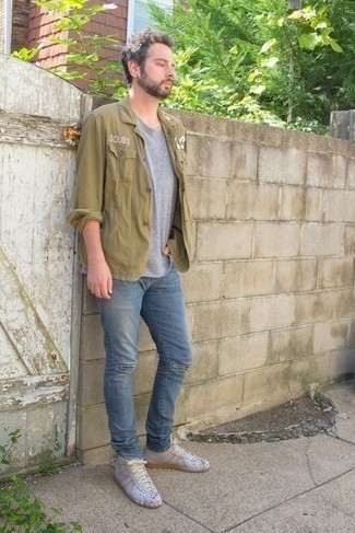 Blue Ripped Jeans Outfits For Men: An olive shirt jacket and blue ripped jeans are absolute menswear must-haves that will integrate perfectly within your current rotation. If you want to immediately play down this ensemble with one single piece, why not complement this ensemble with grey print leather high top sneakers?