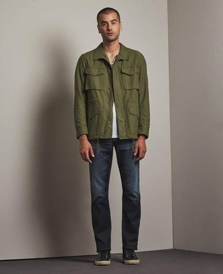 Men's Looks & Outfits: What To Wear In 2020: An olive shirt jacket and navy jeans are among the crucial items in any modern gent's great off-duty closet. Black canvas low top sneakers add a relaxed aesthetic to the ensemble.