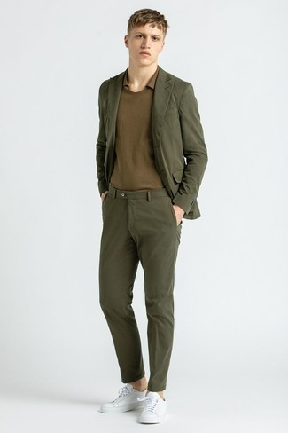 Men's Outfits 2021: An olive suit and a brown polo teamed together are the perfect getup for men who prefer sophisticated ensembles. Rounding off with white leather low top sneakers is a surefire way to inject a playful feel into your getup.