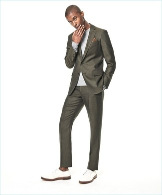 How to wear: olive suit, grey crew-neck sweater, white leather derby shoes, brown print pocket square