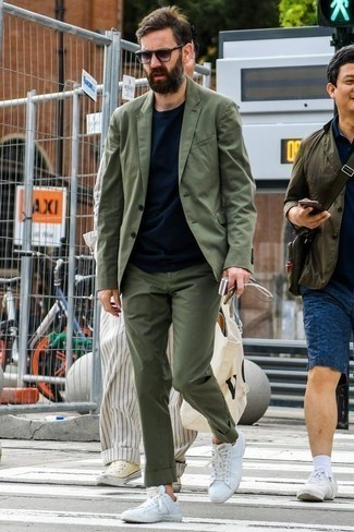 How to Wear a Navy Crew-neck T-shirt For Men: Reach for a navy crew-neck t-shirt and an olive suit to achieve new heights in outfit coordination. You can take a more relaxed approach with footwear and make white canvas low top sneakers your footwear choice.