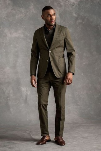 500+ Fall Outfits For Men: Pairing an olive suit and an olive polo neck sweater is a surefire way to inject your current styling rotation with some rugged elegance. As for the shoes, you could go down a more casual route with a pair of dark brown leather loafers. As days are getting cooler, you'll see that an ensemble like this is perfect for the season.