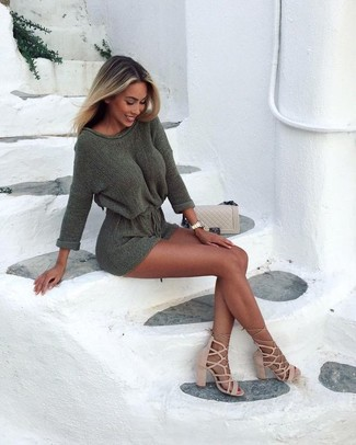 How to Wear an Olive Sweater Dress: Perfect the effortlessly stylish look by opting for an olive sweater dress. To bring out the fun side of you, complete your look with beige suede gladiator sandals.
