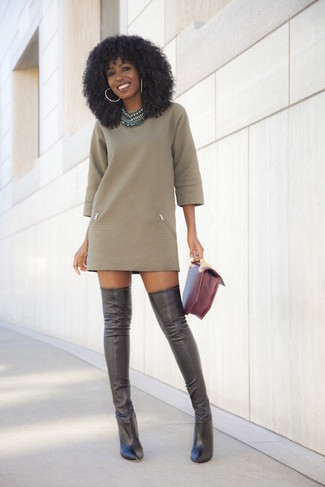 How to Wear a Green Necklace: This pairing of an olive sweater dress and a green necklace is the perfect foundation for an endless number of chic looks. Give your outfit an extra dose of style by finishing with black leather over the knee boots.