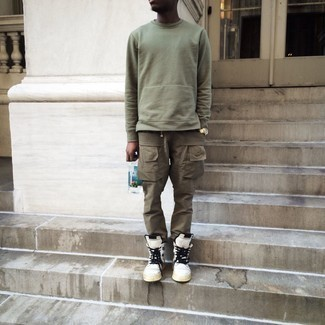 Gold Watch Outfits For Men: An olive sweatshirt and a gold watch worn together are a perfect match. Wondering how to finish off this outfit? Rock a pair of white and black leather high top sneakers to lift it up.
