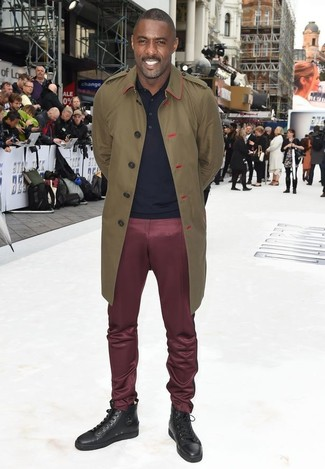 Idris Elba wearing Olive Trenchcoat, Navy Polo, Burgundy Chinos, Dark Brown Leather High Top Sneakers