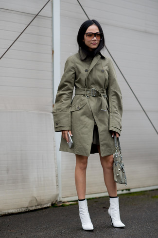 How to wear: olive trenchcoat, white leather ankle boots, olive suede handbag, black socks