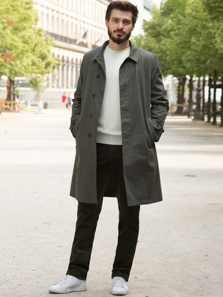 How to wear: olive trenchcoat, white crew-neck sweater, olive corduroy jeans, white leather low top sneakers