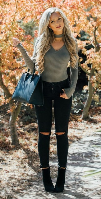How to Wear Black Suede Ankle Boots: For an ensemble that offers function and style, wear an olive v-neck sweater and black ripped skinny jeans. A pair of black suede ankle boots will take this look in a more sophisticated direction.
