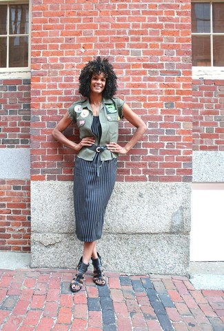 How to wear: olive vest, black vertical striped tank dress, black studded leather heeled sandals, black leather belt