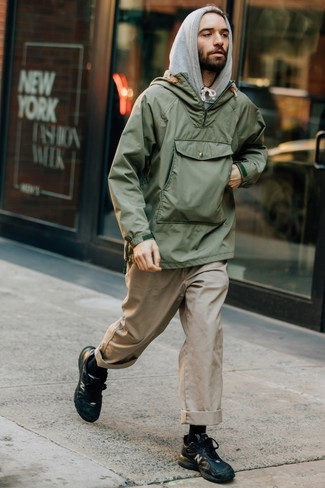 How to wear: olive windbreaker, grey hoodie, beige chinos, black leather athletic shoes