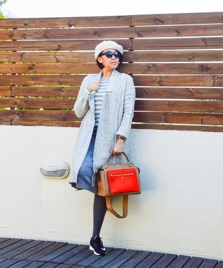 Marry a grey open cardigan with a blue a-line skirt for a Sunday lunch with friends. Black athletic shoes will add a new dimension to an otherwise classic look.