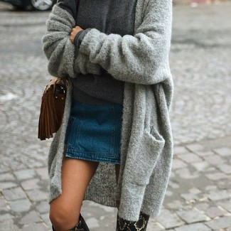How to Wear Black Leather Knee High Boots Casually: Such essentials as a grey knit open cardigan and a blue denim mini skirt are an easy way to introduce some cool into your daily off-duty routine. Put a dressier spin on your ensemble by sporting a pair of black leather knee high boots.