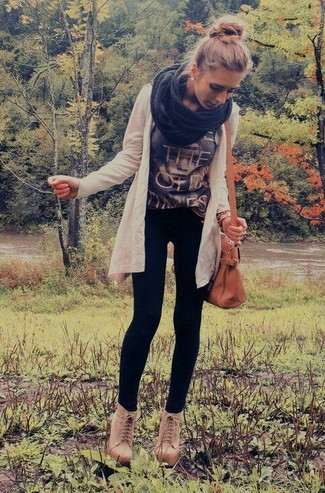 Something as simple as opting for a beige open cardigan and black leggings can potentially set you apart from the crowd. For footwear go down the classic route with tan leather booties.