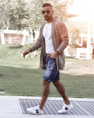 How to wear: grey open cardigan, white crew-neck t-shirt, blue ripped denim shorts, white print low top sneakers